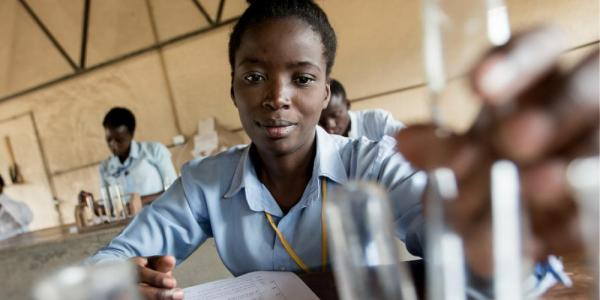 African woman studying in a science classroom
