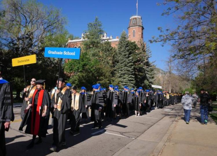 PhD candidates on their way to commencement. New research published this week offers insight into the career trajectories that may await them. (Photo by Glenn Asakawa/CU Boulder)