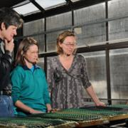 Computer Science Professor Liz Bradley (left), meets with Rhonda Hoenigman (center) and their collaborator, Assistant Professor in Ecology & Evolutionary Biology Nichole Barger, to discuss an algorithm that determines where plants will grow efficiently.