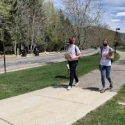 Volunteers, part of the Utah HERO project, walk down a neighborhood path.