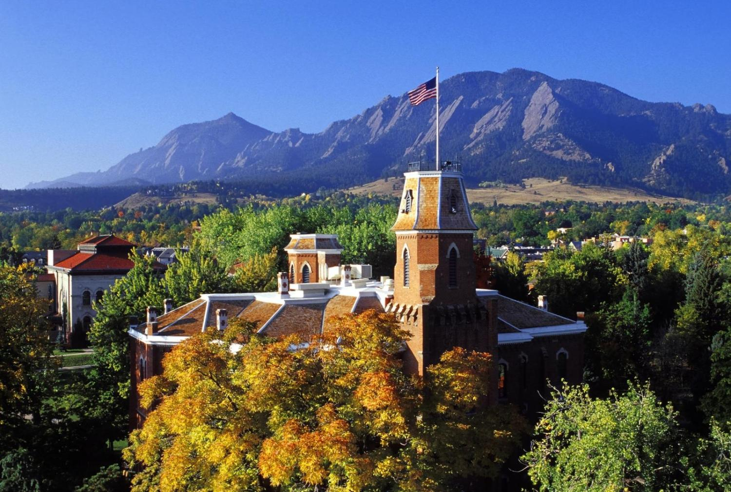 Old Main with flatirons in the background