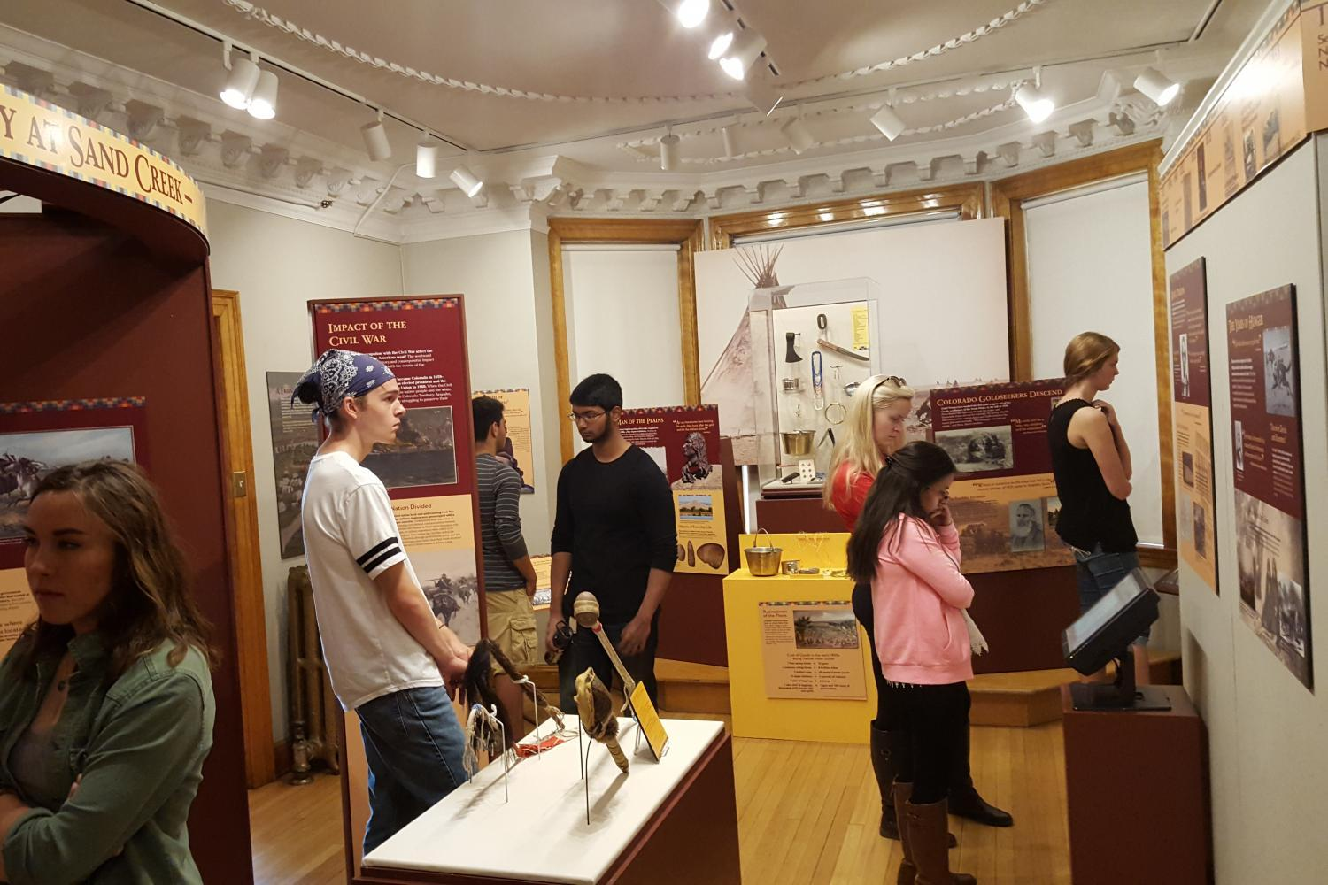 Students looking at an exhibit on Chief Niwot