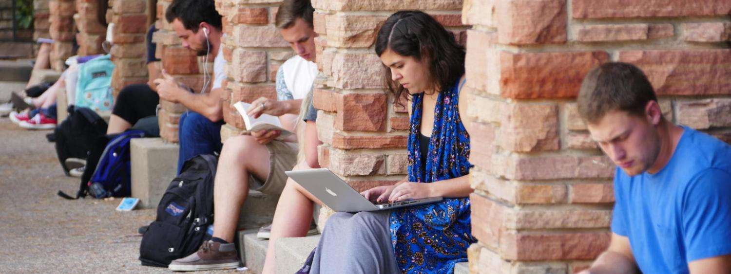 Students studying outside the University Memorial Center.
