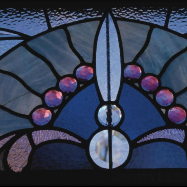 Close-up of stained-glass window in Macky Auditorium. Details and close-ups can help tell a broader story.