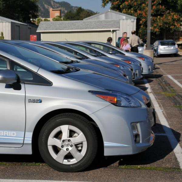 Hybrid cars lined up in a lot on campus. Repetition of form and subject can make an interesting composition.