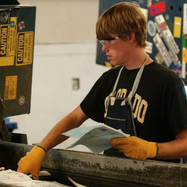Student sorting at the Recycling Center. Rule of thirds employed to create a clean and easily read image.