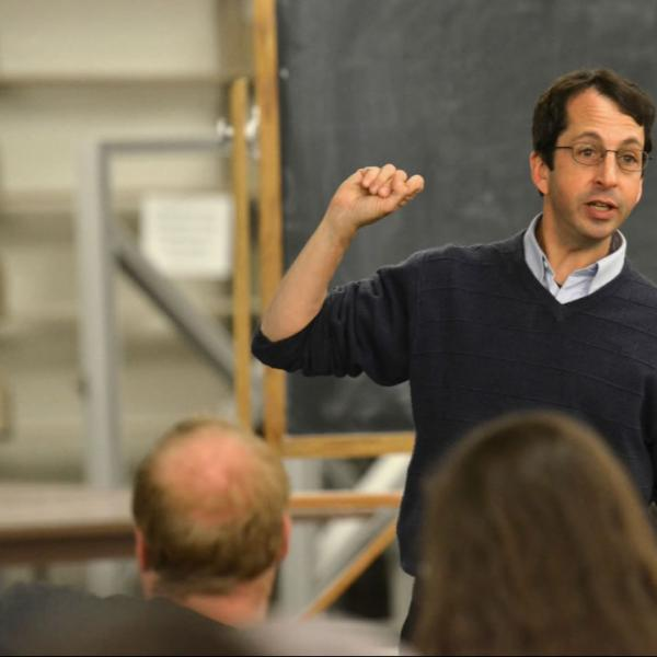 Physics professor Stephen Pollock teaches in class. Photograph simply and make the subject stand out.