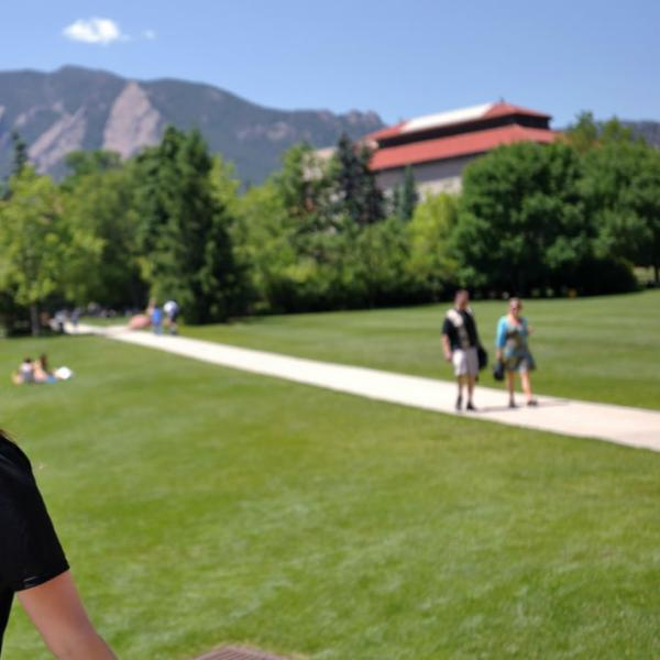 A CU Ambassador leads a tour through the quad. Shallow depth of field helps focus your attention on the subject and gives images a more sophisticated look that is very contemporary.