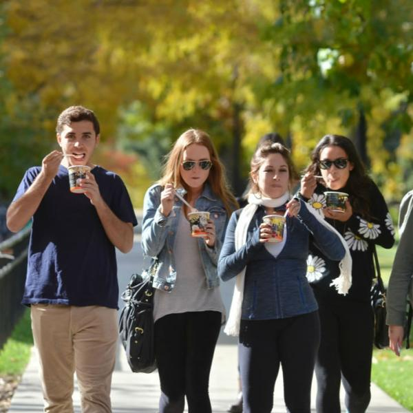 Students enjoy ice cream after a visit to University Hill. Another example of putting the sun behind subjects to make the light on them look even and clean.