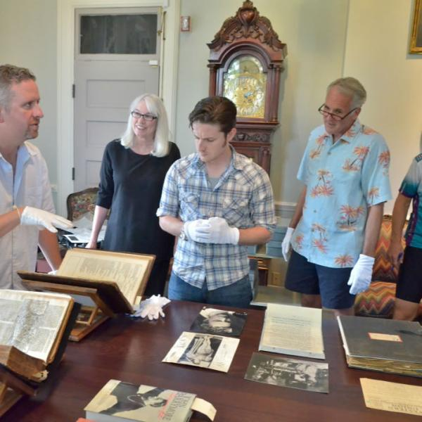 Unveiling historic documents at Old Main. Be conscious of all the elements and/or people in the images you are capturing.