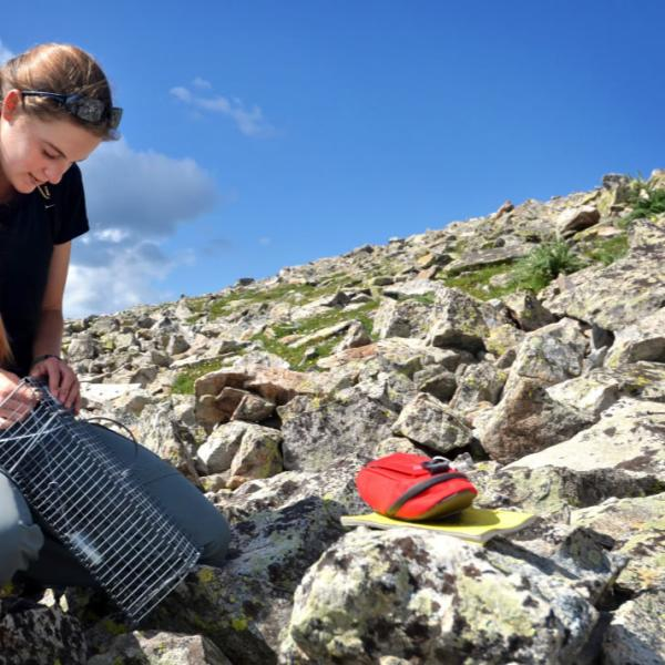A student performs mountain research. A wide-angle lens in the field allows for a more intimate and immersive view.