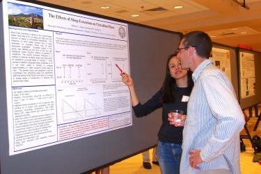 A student presents her academic poster
