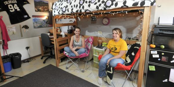 Two girls sitting in their residence hall room