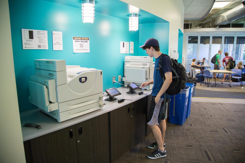 student using printer