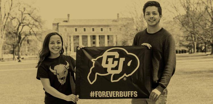 Students hold forever buffs signs on norlin quad