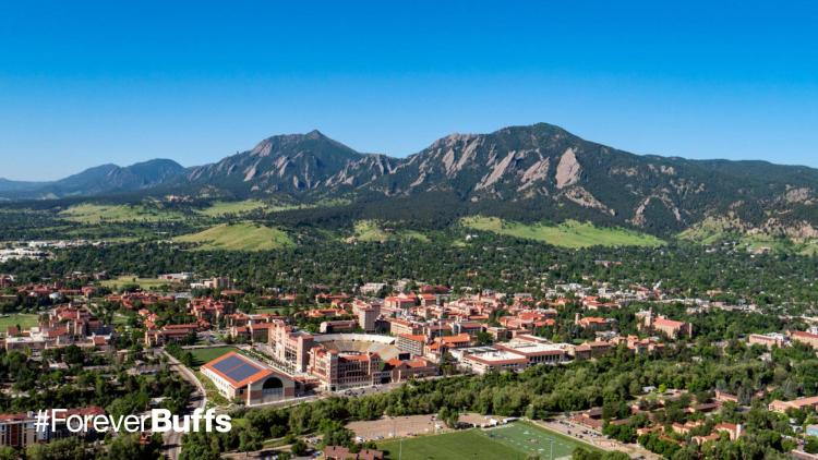 Ariel photo of campus with flatirons in the background
