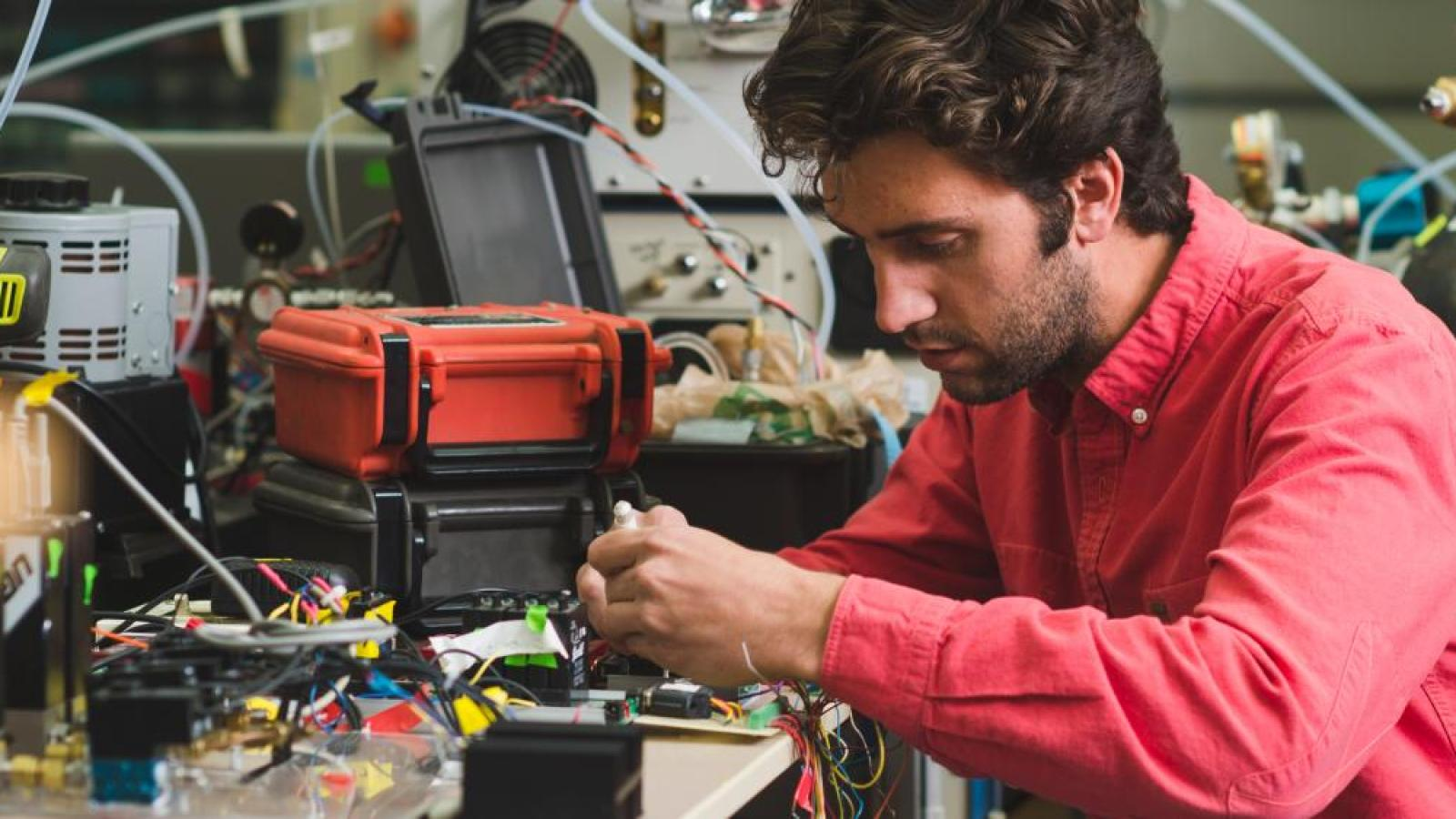 A male engineering student works on a project.