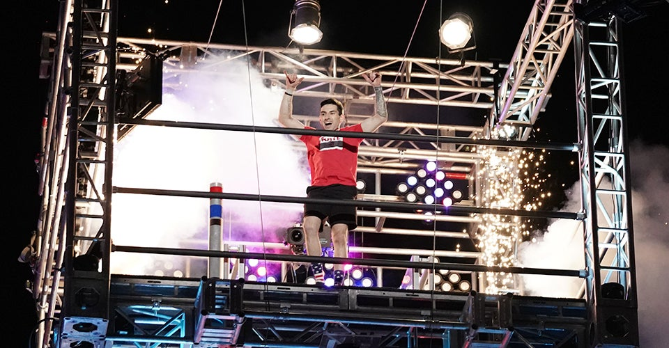 Nate Hansen celebrateing after completing the course on 'American Ninja Warrior.'