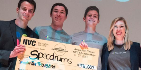 New Venture Challenge winners standing with their prize