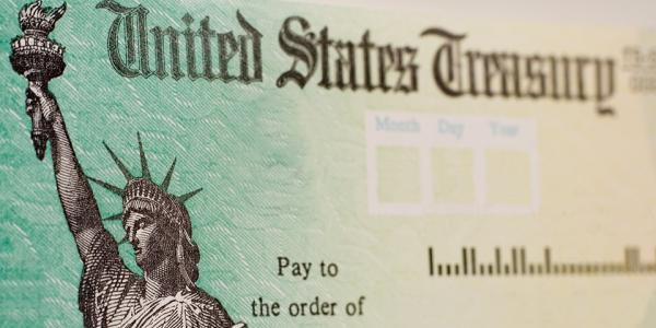 A blank check bearing the marks of the U.S. Treasury.