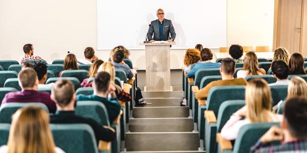 Faculty leading a lecture in a classroom