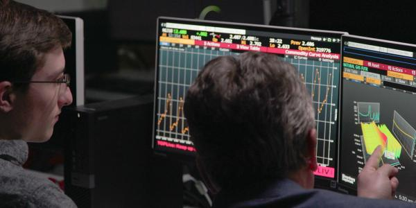 Burridge Center's Bloomberg trading lab with trading terminals