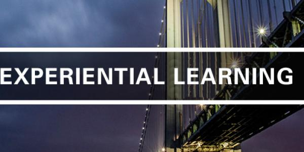 the words Experiential Learning set against a city skyline at night