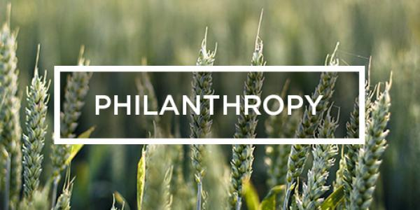 the word Philanthropy against rows of wheat