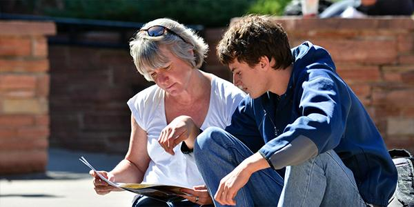 Mother and prospective business student reviewing financial aid
