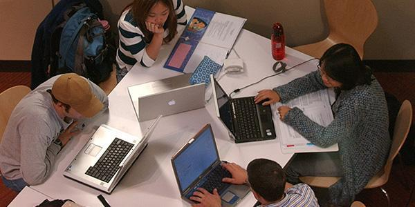 Pre-Business Program students working on computers
