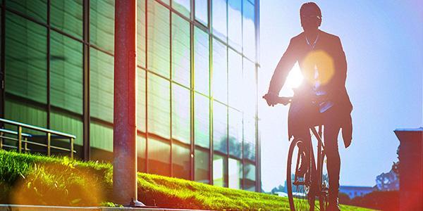 A man biking to promote sustainability