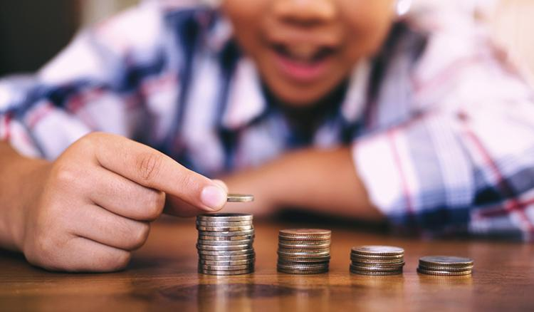 young-child-stacking-coins-banking-research