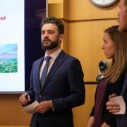 Graduate students presenting at the Natural and Organic Case Competition