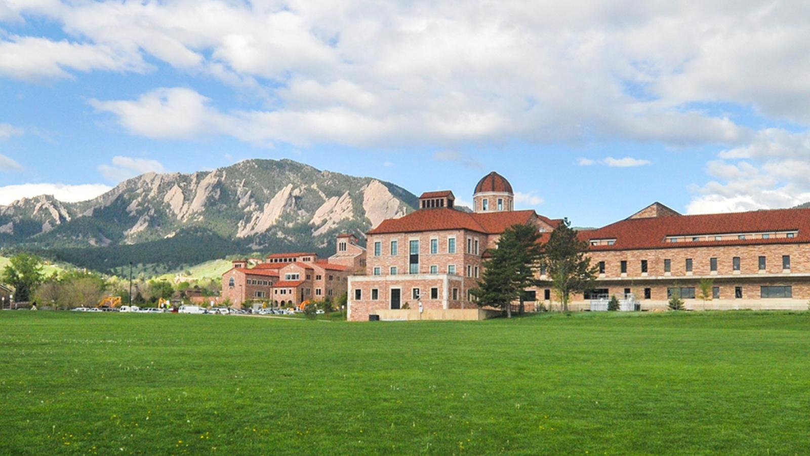 The Koelbel building with the Flatirons in the background