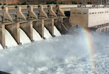 Ice harbor hydro dam with a rainbow
