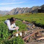 women testing water quality in mountains