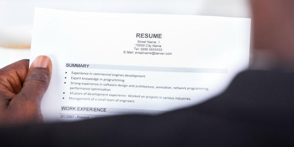 Student holding resume