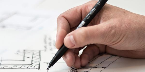 person drawing plans