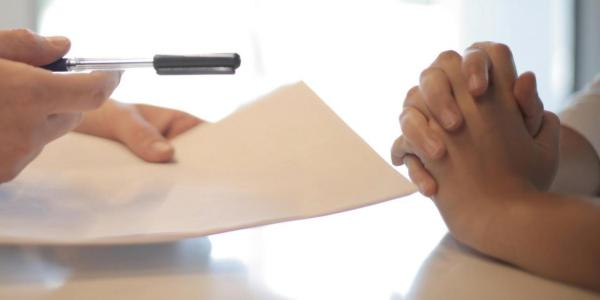 person pointing with a pen