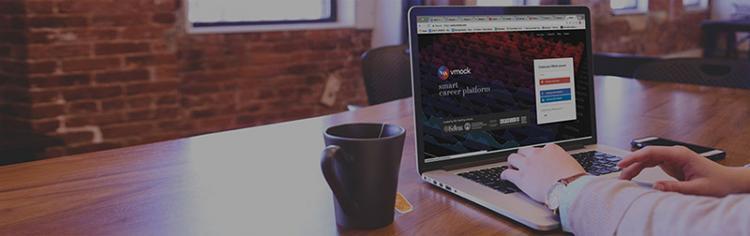 Laptop and coffee mug on a table