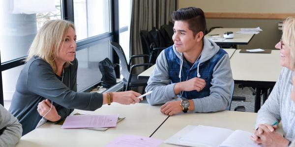 People talking in a workshop