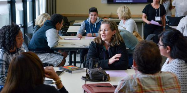 workshop students and teachers talking
