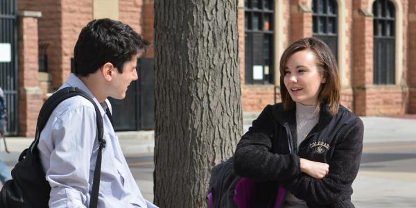 female and male students talking