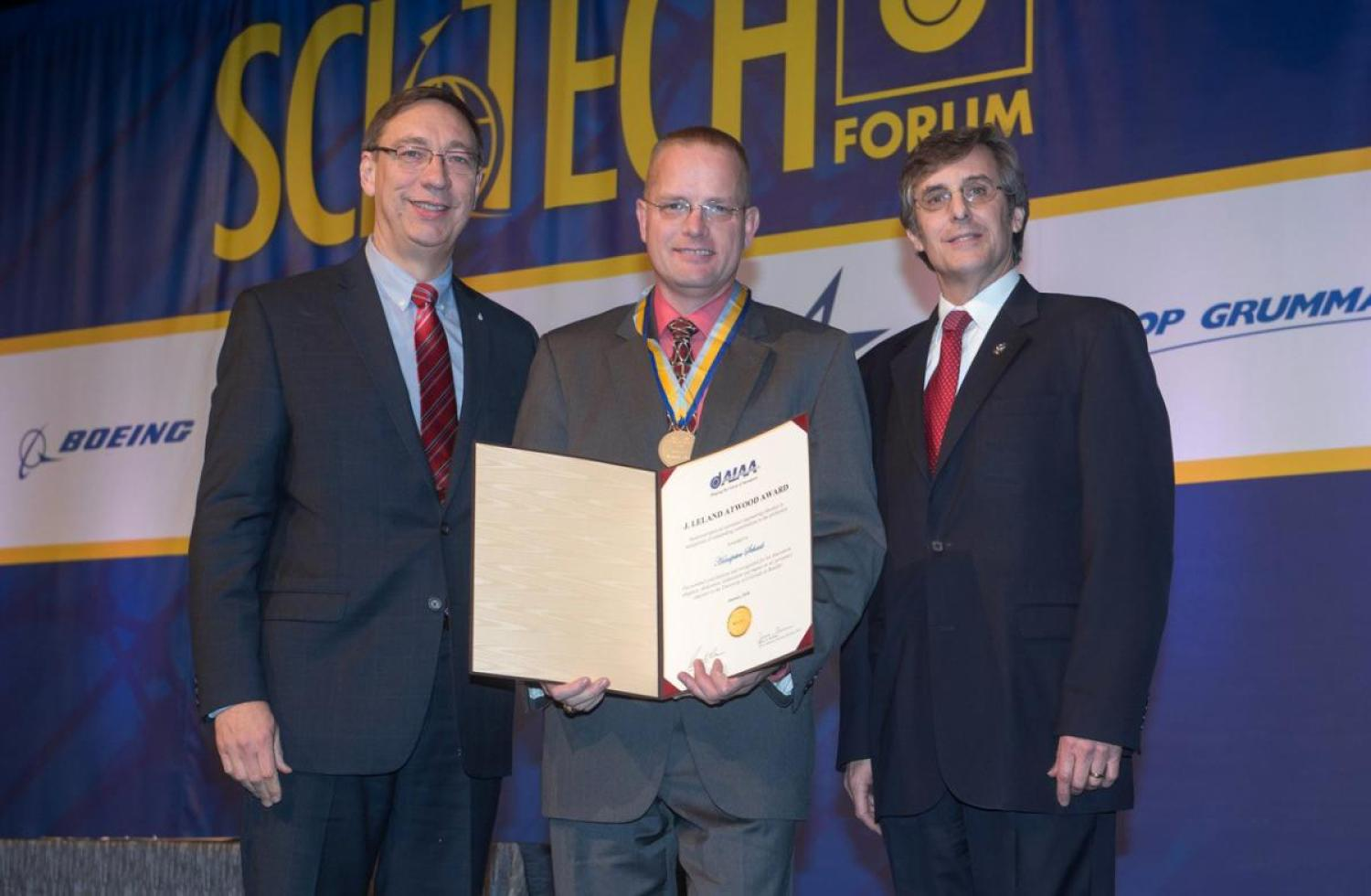 Hanspeter Schaub receiving the J. Leland Atwood Award