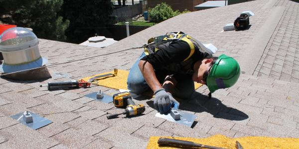 Student installing solar panel