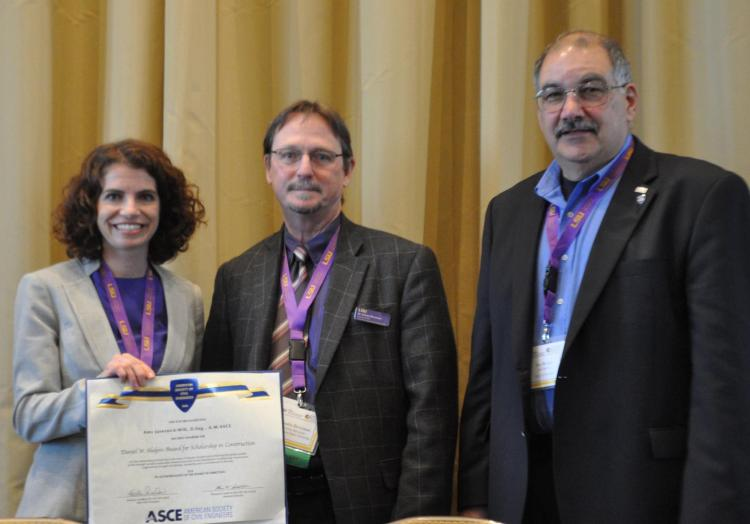 Amy Javernick-Will (left) receives her award from two ASCE leaders.