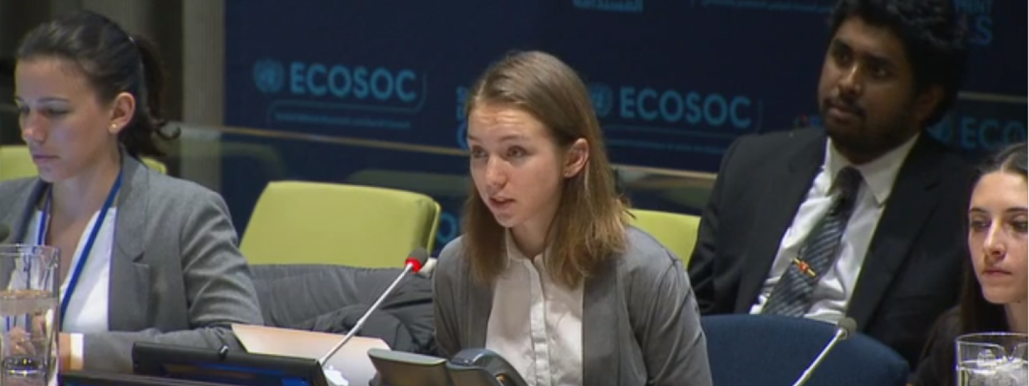 Kimmy Pugel speaks into the microphone while serving on a UN panel.