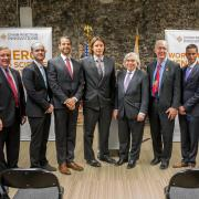 Tyler Huggins and Justin Whiteley pose with DOE and Argonne VIPs at a press conference announcing the first Chain Reaction Innovations cohort.