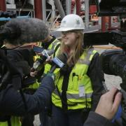 Ellen Becker, a project engineer with Mortenson Construction, the construction manager for the arena project, talks to the media in early May as the first roof truss of the future Milwaukee Bucks arena are installed. (Photo: Mike De Sisti, Milwaukee Journal Sentinel)