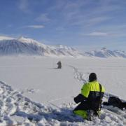 Researchers collecting spectral reflectance measurements of surface snow with corresponding snow samples in Northern Svalbard.
